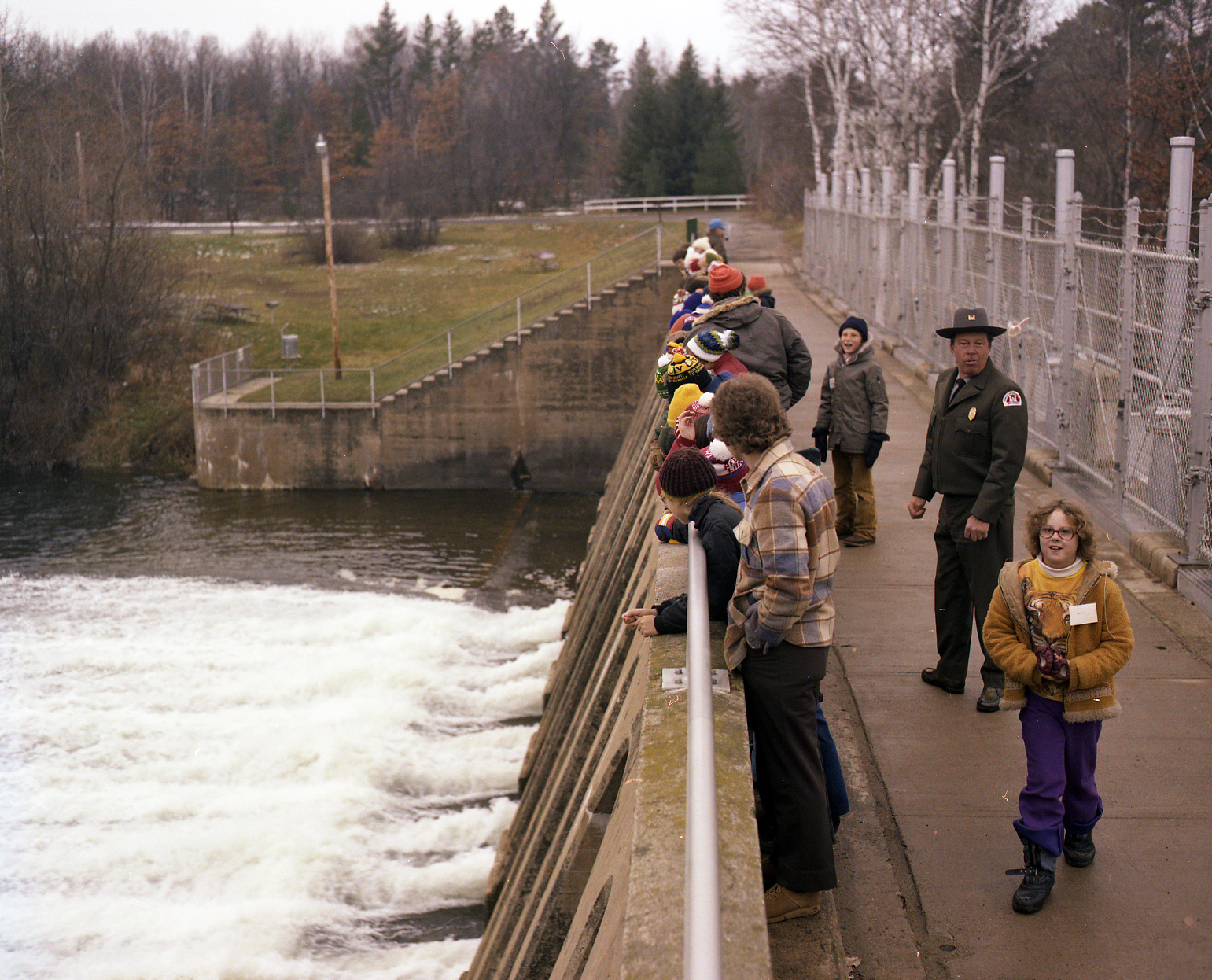 Park manager with children on top of Pine River Dam