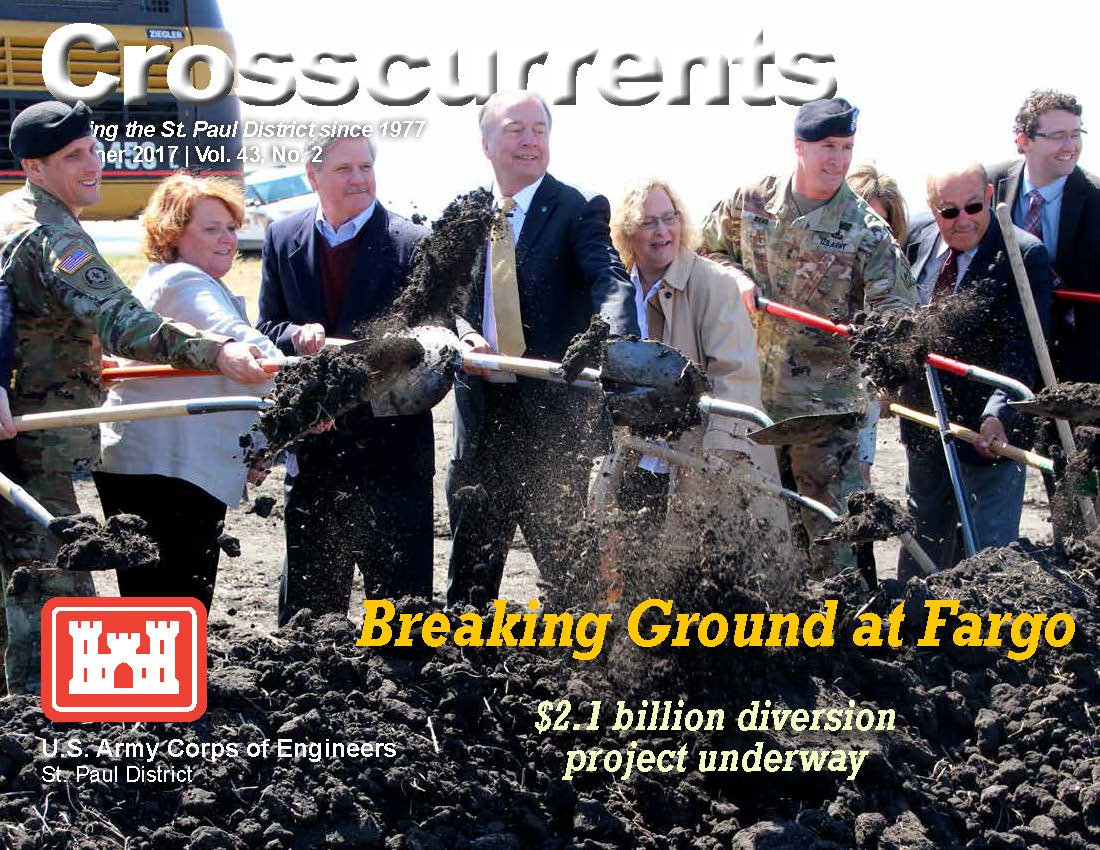 people shovelling dirt in breaking ground ceremony